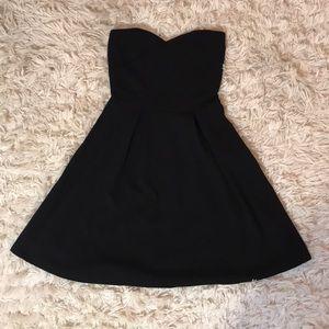 Small strapless mini black dress